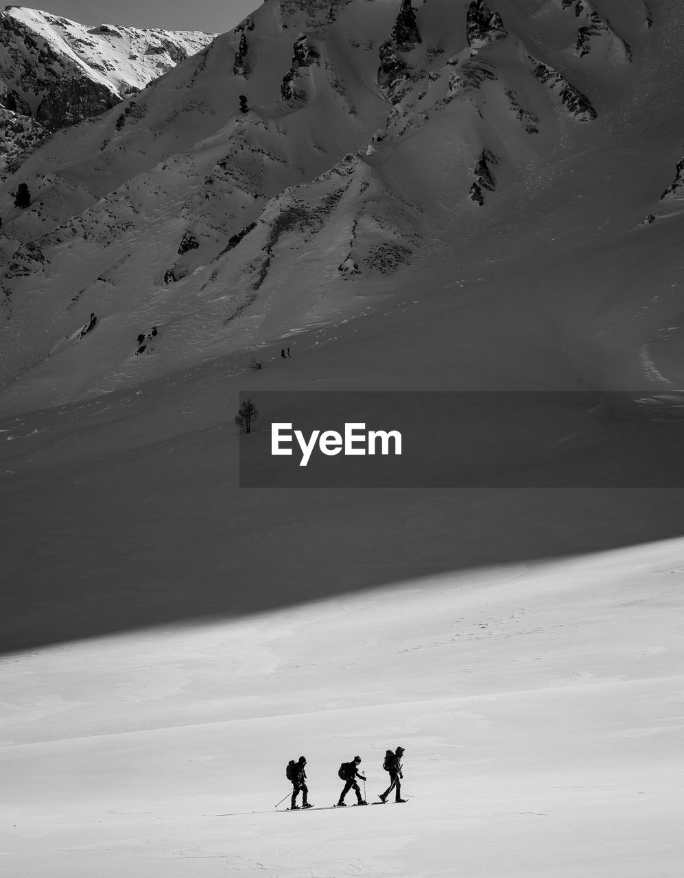 High Angle View Of People Walking On Snow Covered Landscape