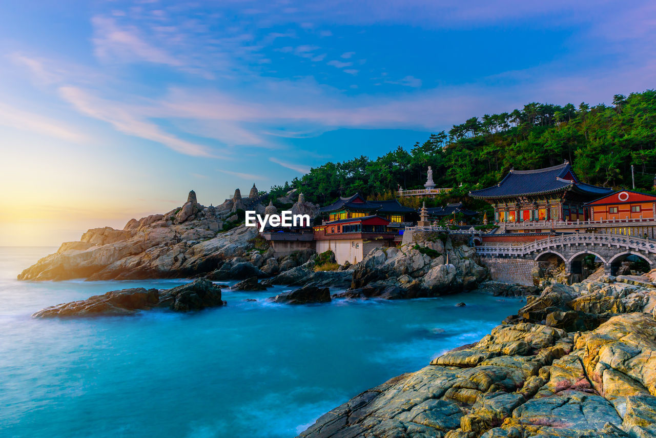water, sea, sky, rock, rock - object, built structure, architecture, solid, scenics - nature, building exterior, beauty in nature, nature, building, cloud - sky, rock formation, land, no people, sunset, beach, outdoors