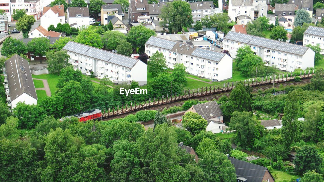High Angle View Of Railroad Track Surrounded By Trees In City