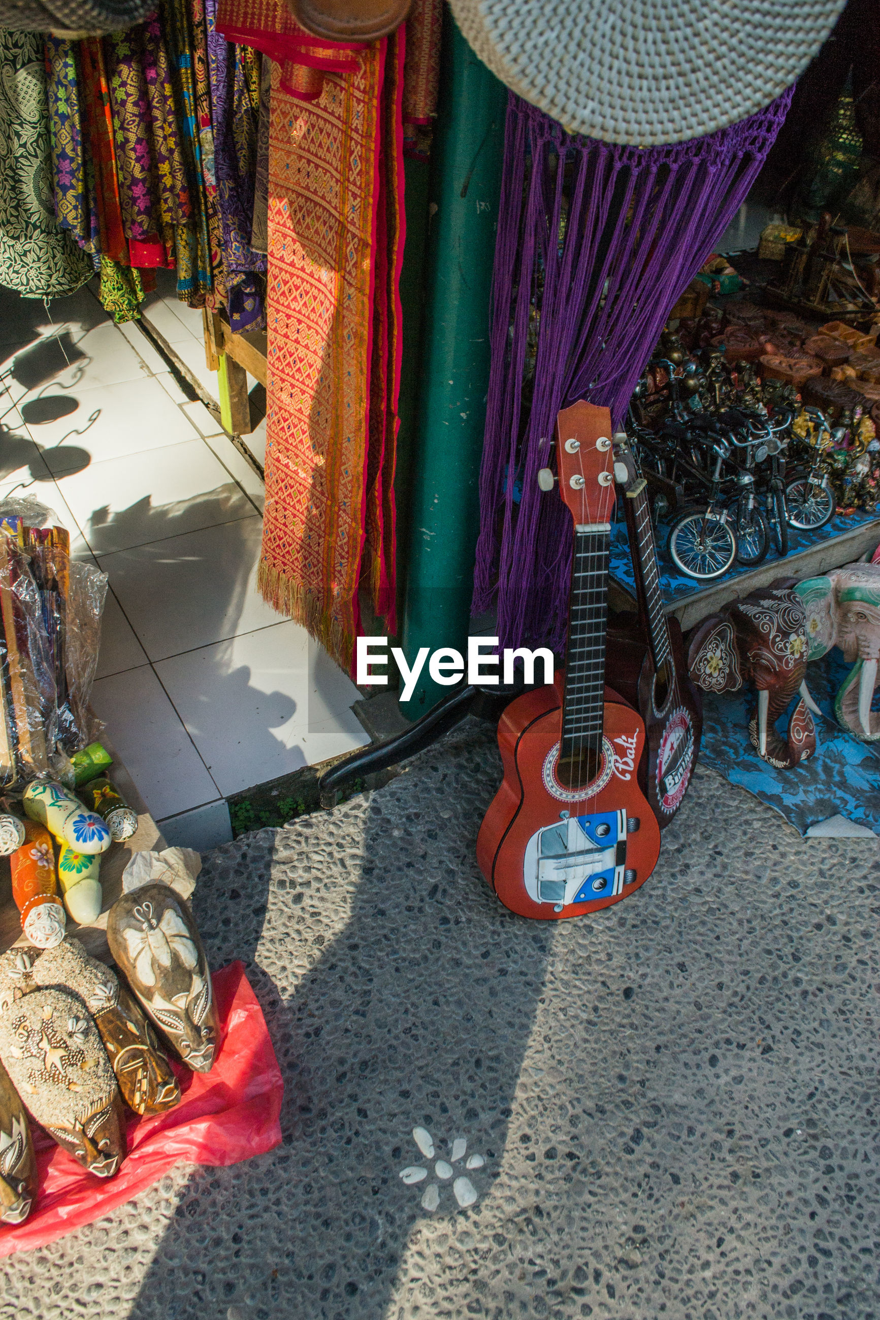 High angle view of guitar and souvenirs for sale at market
