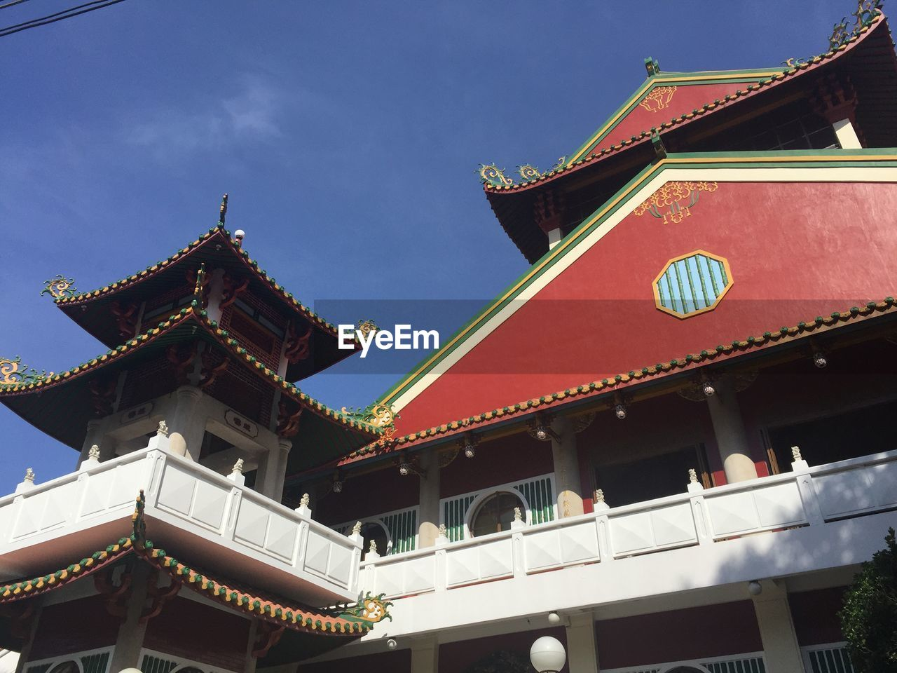architecture, built structure, building exterior, religion, low angle view, pagoda, place of worship, eaves, cultures, spirituality, traditional building, travel destinations, no people, outdoors, tradition, day, dragon, roof, sky