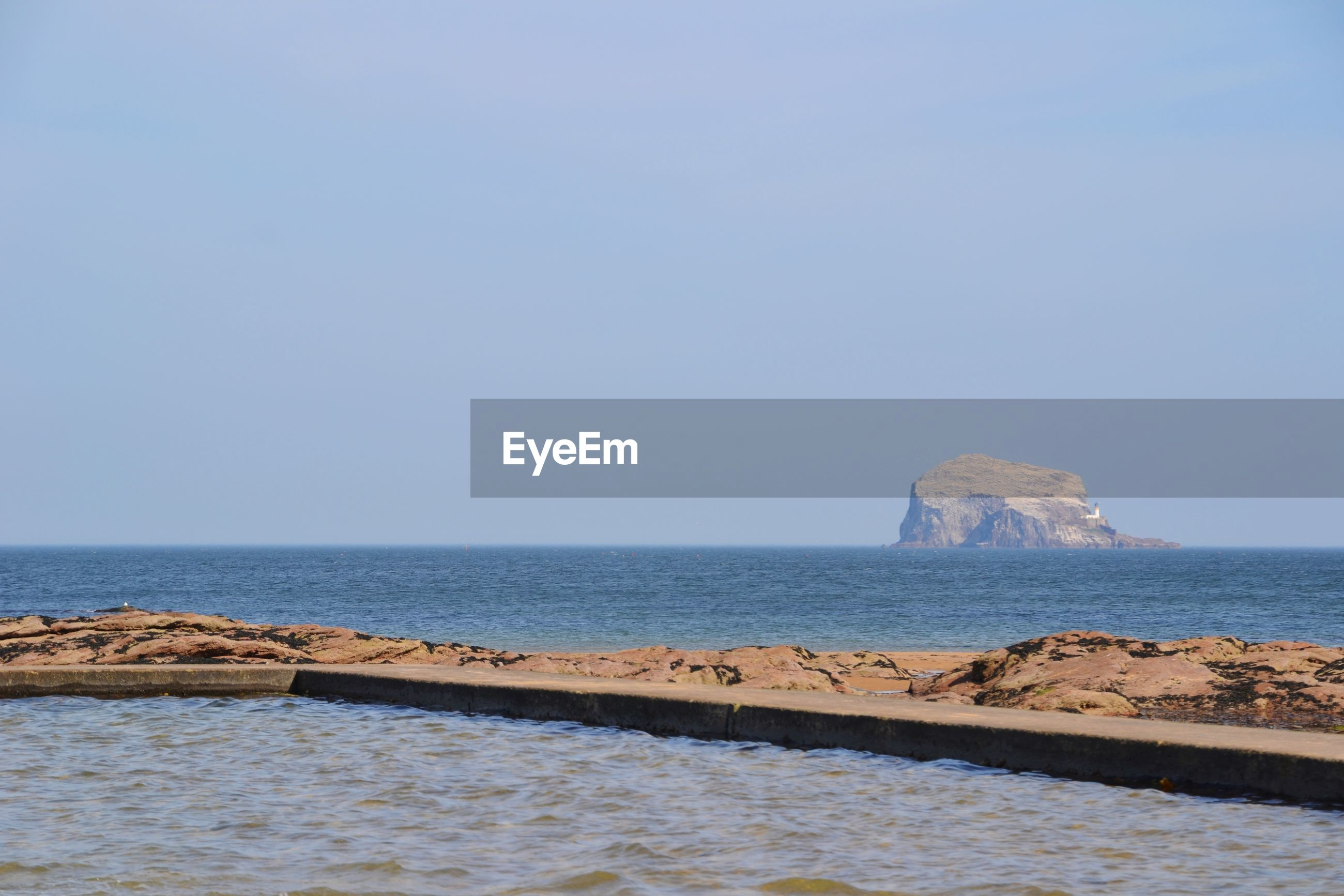 Scenic view of island in sea