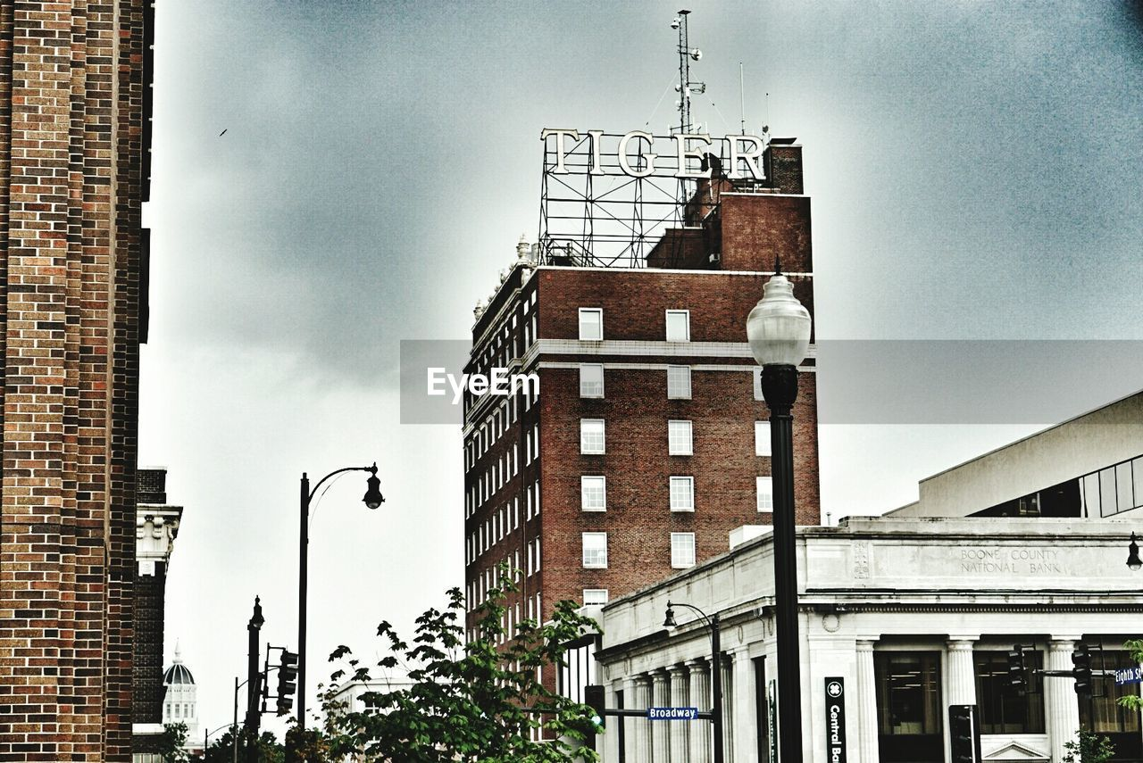 LOW ANGLE VIEW OF BUILDINGS AGAINST SKY