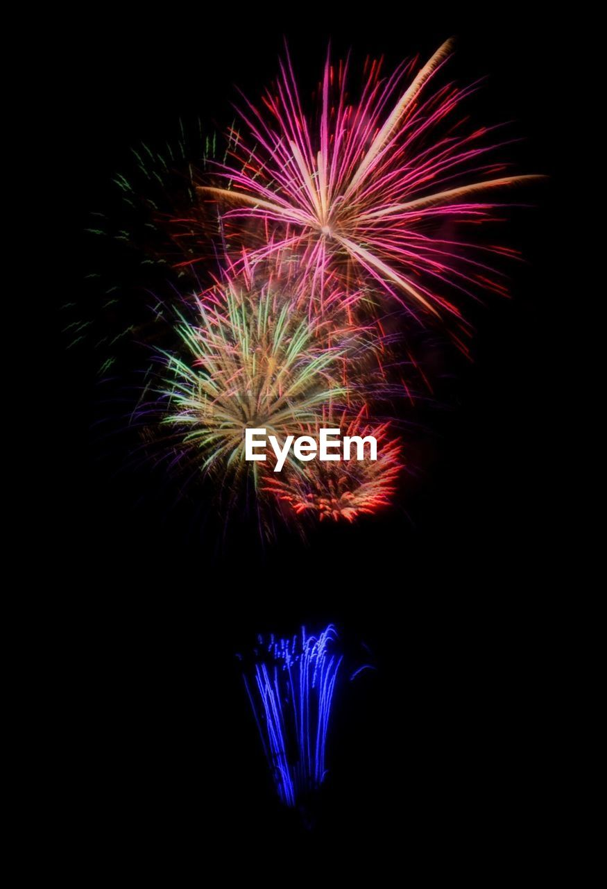 night, firework display, exploding, celebration, firework - man made object, arts culture and entertainment, no people, motion, long exposure, multi colored, illuminated, low angle view, black background, outdoors, sky