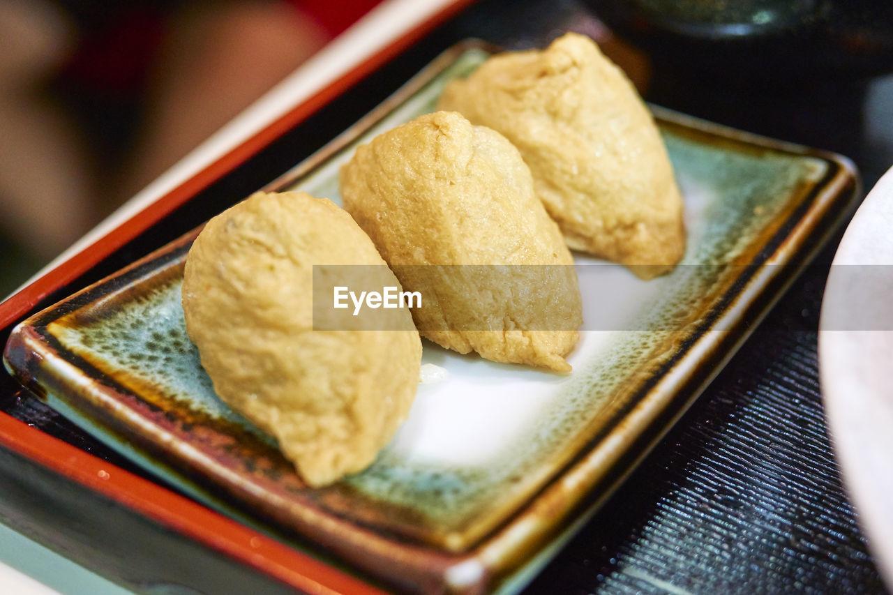 Close-up Of Fried Dumplings On Plate