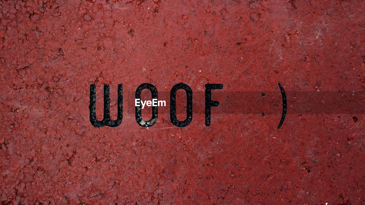 text, western script, communication, red, day, no people, outdoors, single word, close-up, textured, architecture