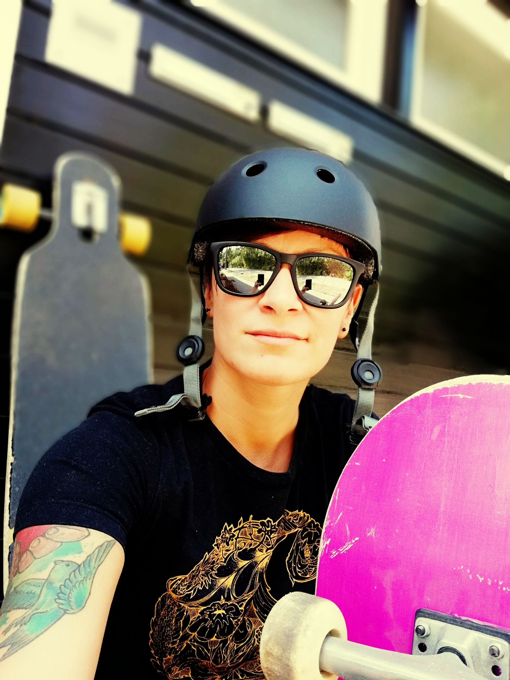 Portrait of woman wearing sunglasses and sports helmet