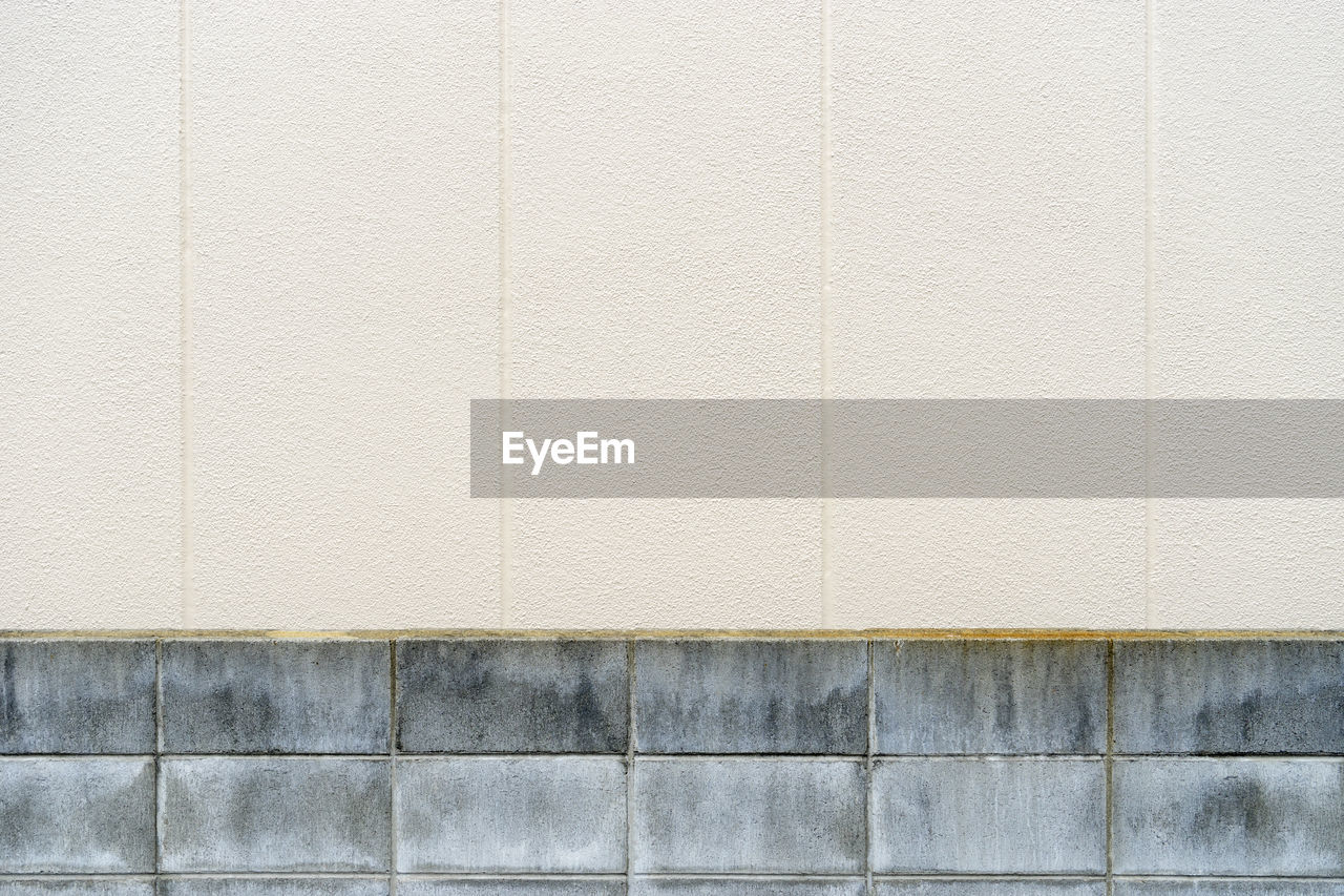 wall - building feature, architecture, built structure, backgrounds, pattern, copy space, textured, no people, wall, full frame, concrete, flooring, day, white color, beige, tile, close-up, building exterior, outdoors, brick wall