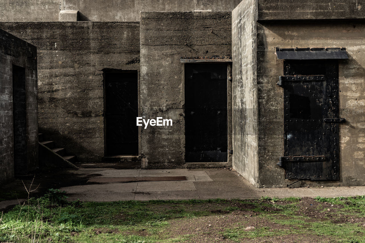 architecture, abandoned, built structure, building, entrance, old, door, history, outdoors, no people, spooky, building exterior, the past, remote, solitude, empty, nature, strength, weathered