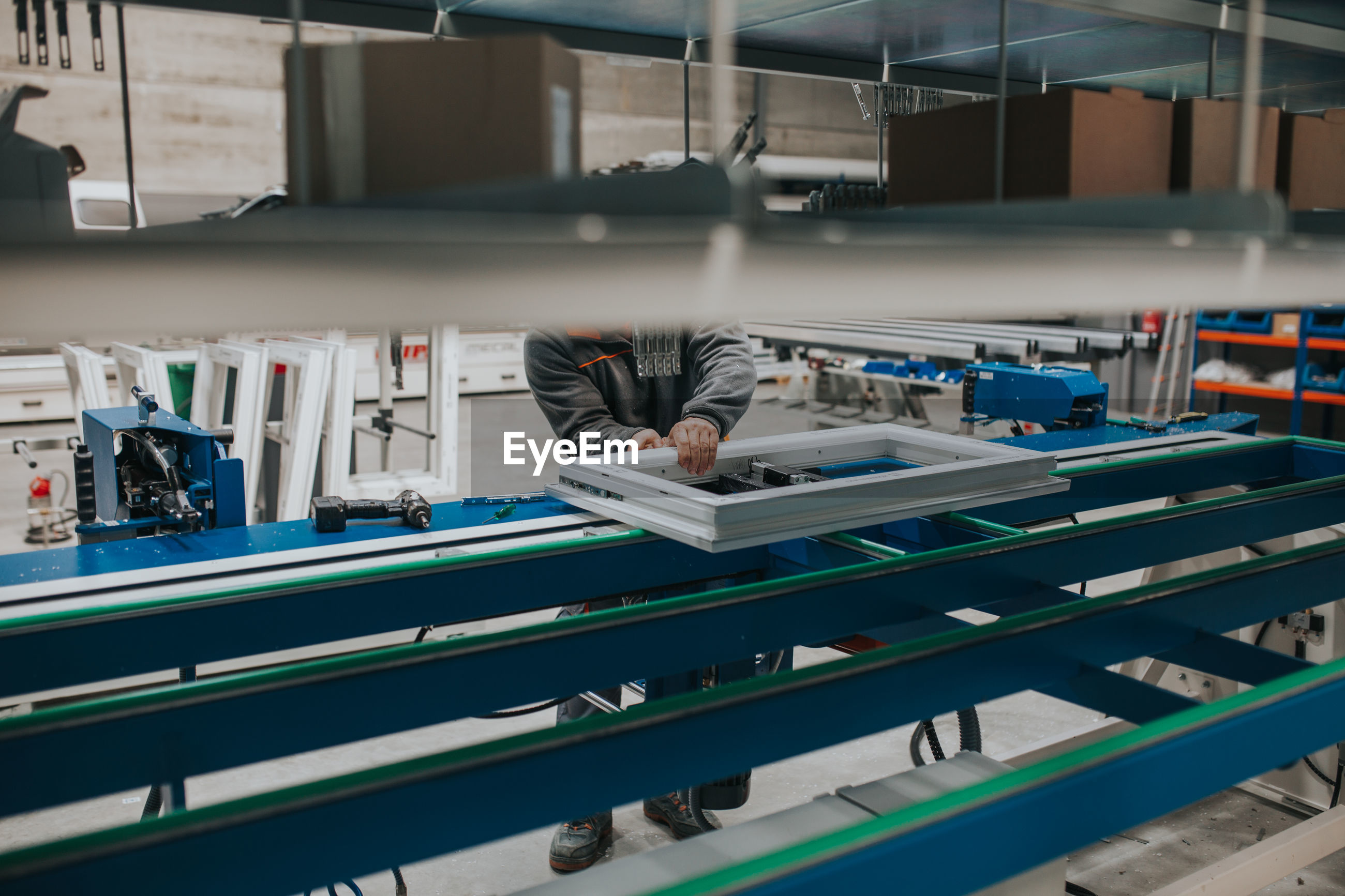 Low section of man working in factory