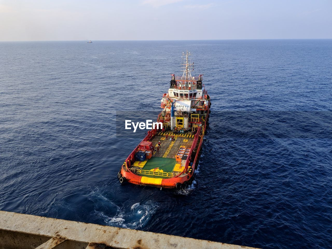 sea, water, nautical vessel, transportation, horizon over water, mode of transportation, horizon, sky, day, nature, high angle view, offshore platform, scenics - nature, industry, outdoors, beauty in nature, no people, ship, business