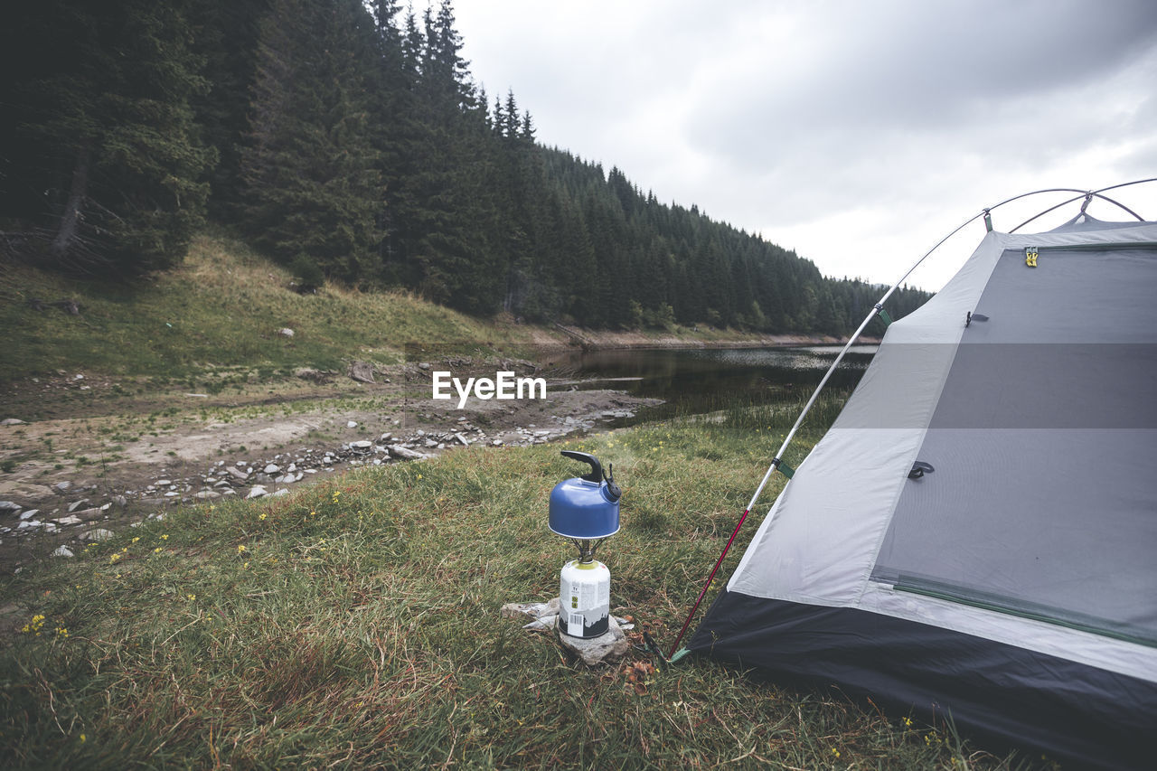 Camping Stove And Tent On Field Against Sky