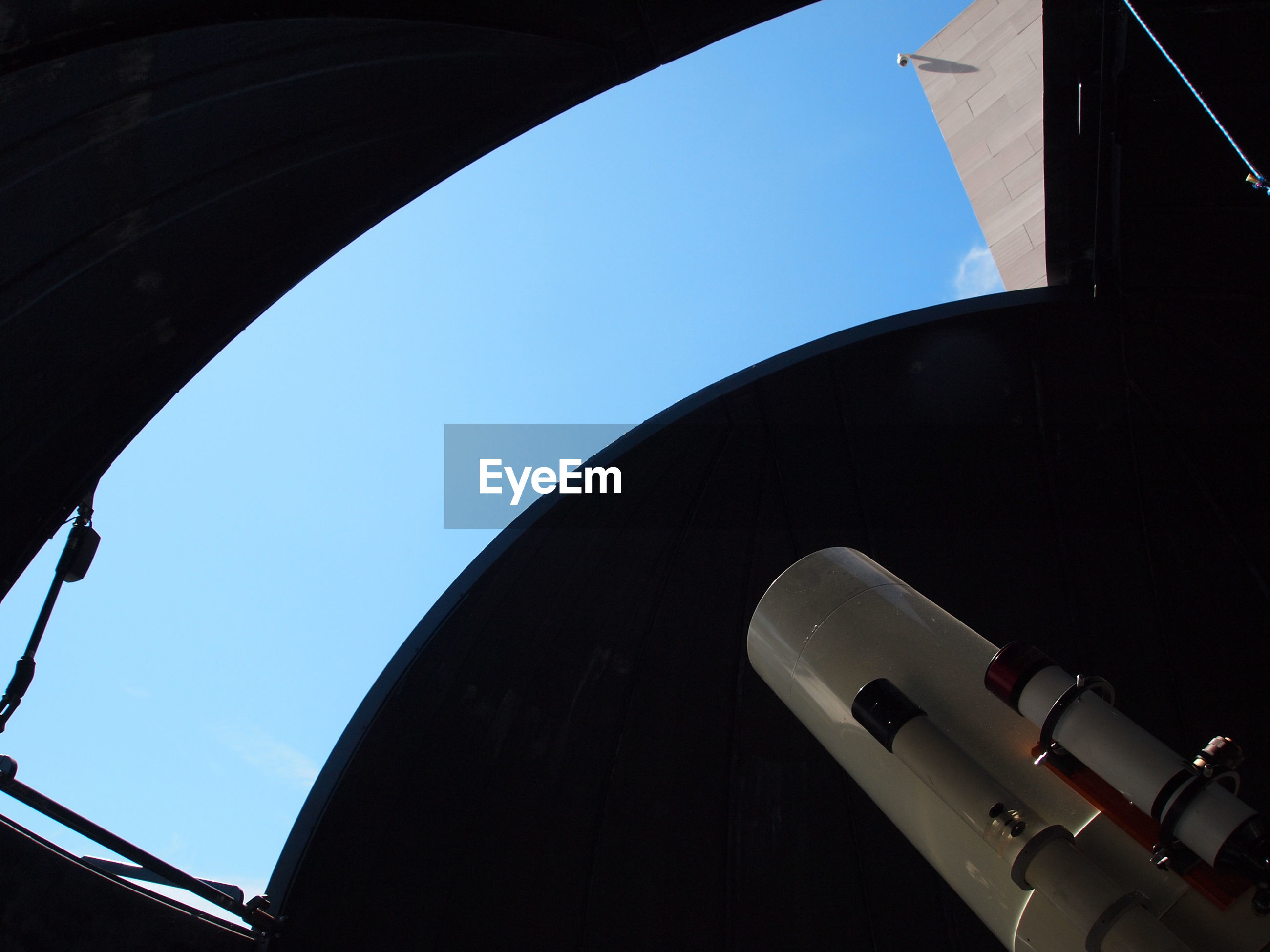 Low angle view of telescope against clear sky