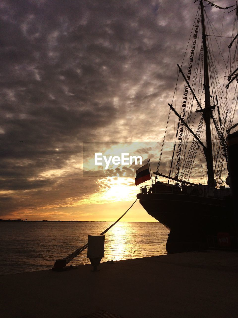 sunset, sea, water, nautical vessel, silhouette, nature, sky, beauty in nature, scenics, tranquility, tranquil scene, horizon over water, cloud - sky, mast, mode of transport, no people, transportation, outdoors, sailboat, sun, moored, travel destinations, sailing ship, sailing, tall ship, day