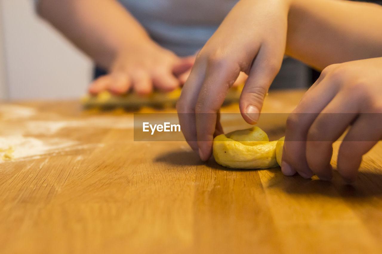 Close-Up Of People Preparing Food