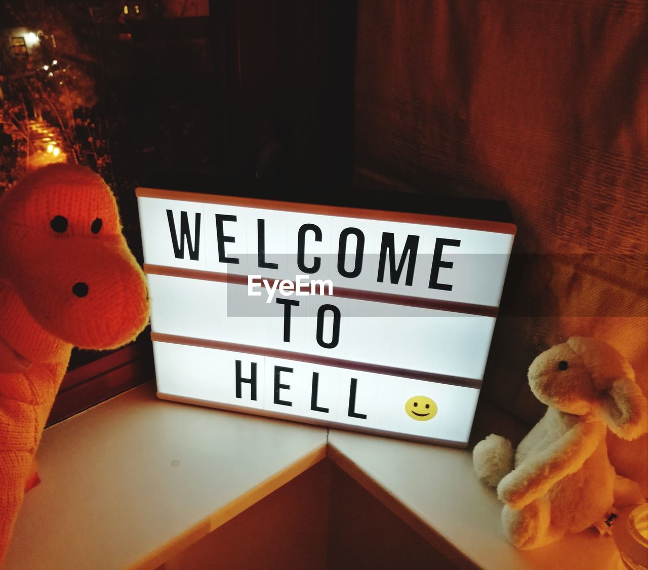 indoors, text, toy, representation, no people, communication, western script, stuffed toy, close-up, still life, capital letter, human representation, home interior, art and craft, table, number, orange color, message