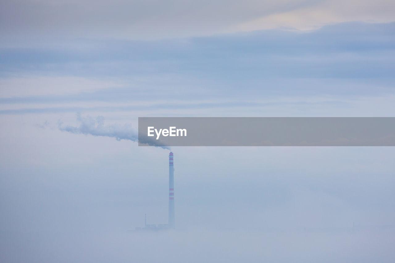 Smoke Emitting From Chimney Against Sky