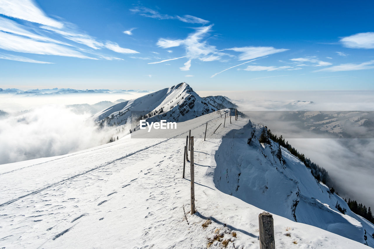 winter, snow, cold temperature, beauty in nature, mountain, scenics - nature, tranquil scene, sky, cloud - sky, tranquility, landscape, environment, white color, non-urban scene, mountain range, snowcapped mountain, nature, idyllic, covering, no people, mountain peak