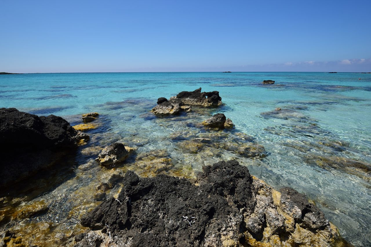 sea, water, sky, horizon over water, rock, horizon, scenics - nature, beauty in nature, rock - object, solid, clear sky, nature, tranquil scene, tranquility, blue, no people, land, idyllic, day, outdoors, shallow, marine, rocky coastline, turquoise colored