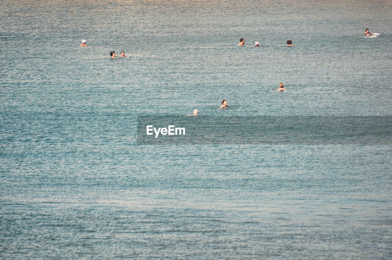 People Swimming In The Sea