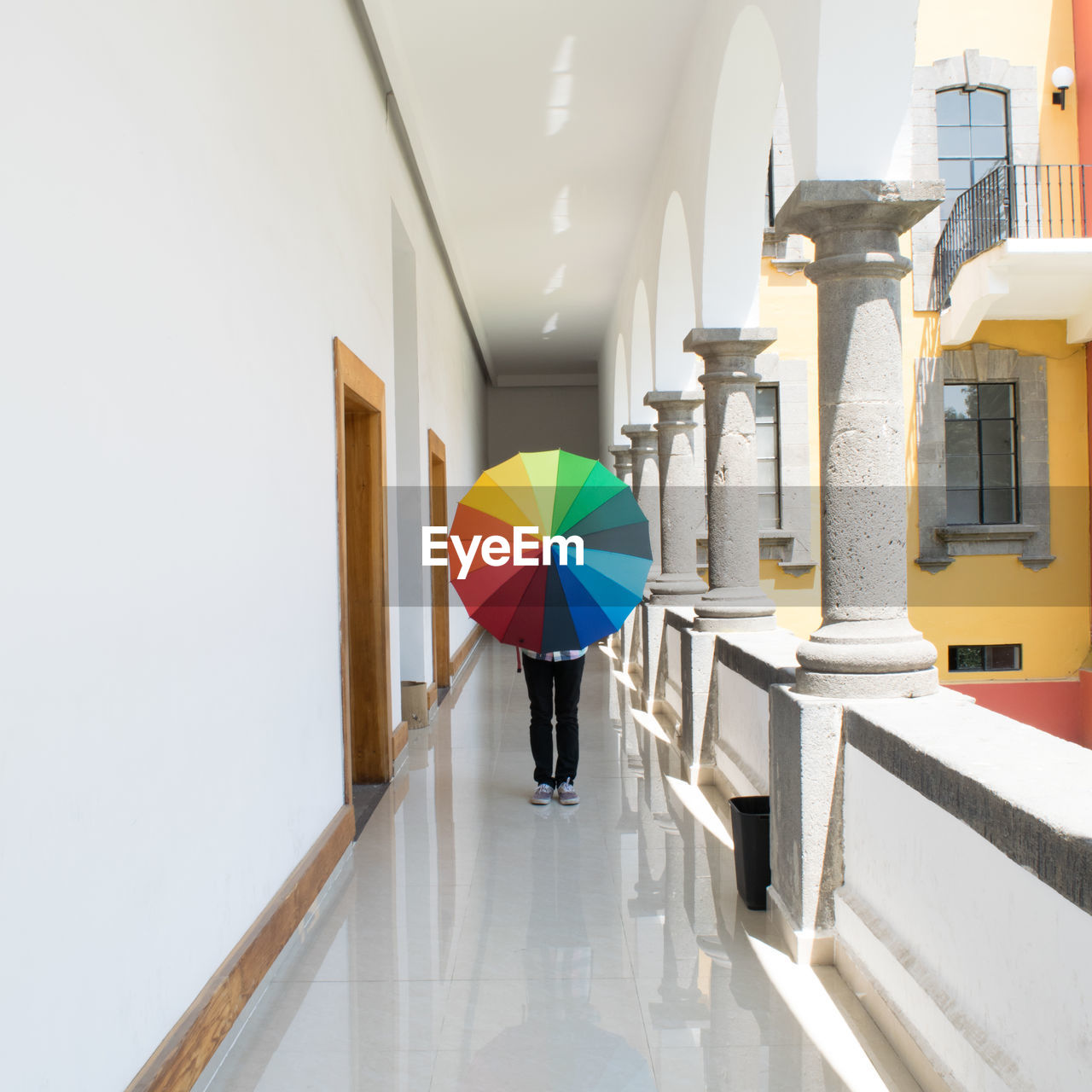 real people, architecture, built structure, one person, walking, corridor, architectural column, full length, indoors, day