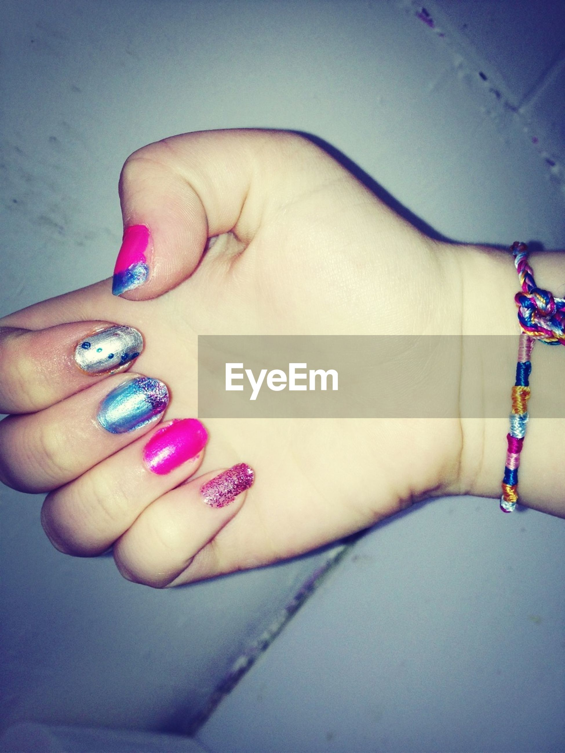 person, indoors, part of, human finger, holding, cropped, jewelry, close-up, bracelet, nail polish, personal perspective, lifestyles, studio shot, high angle view, unrecognizable person, ring
