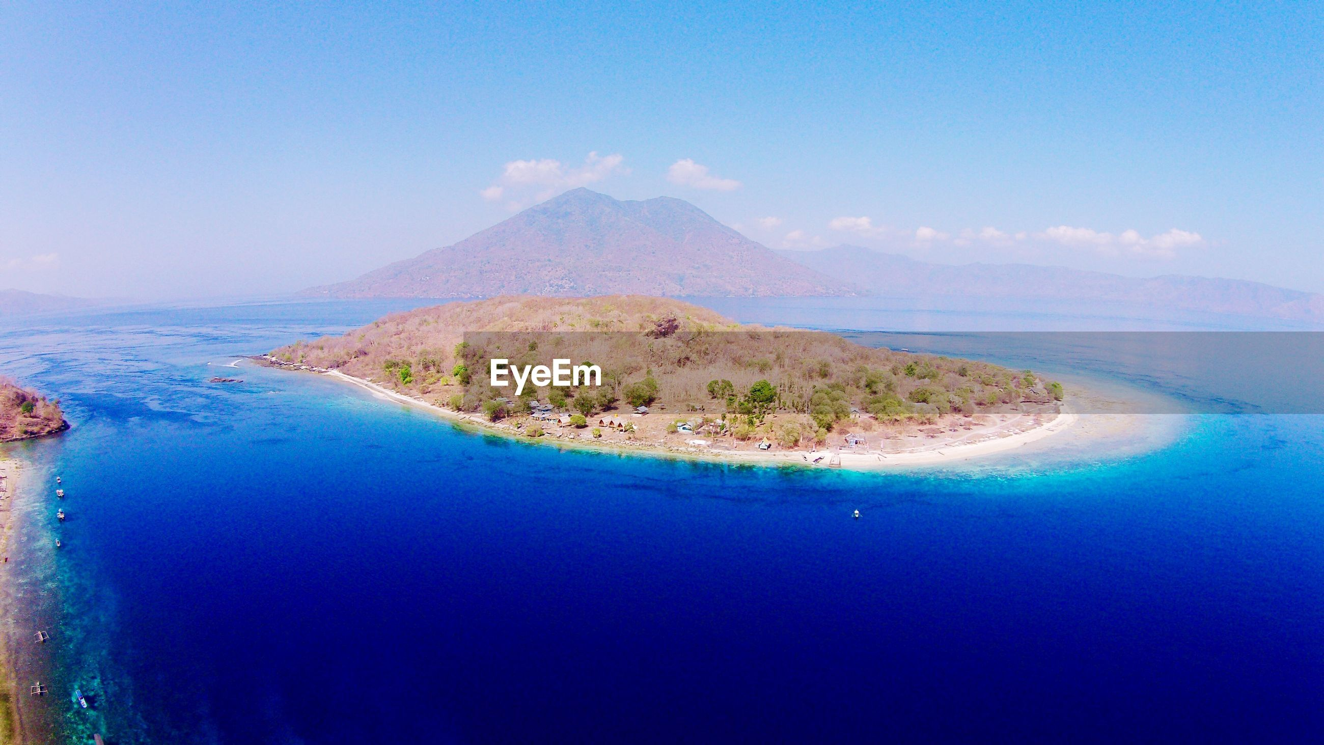 Scenic view of island against sky