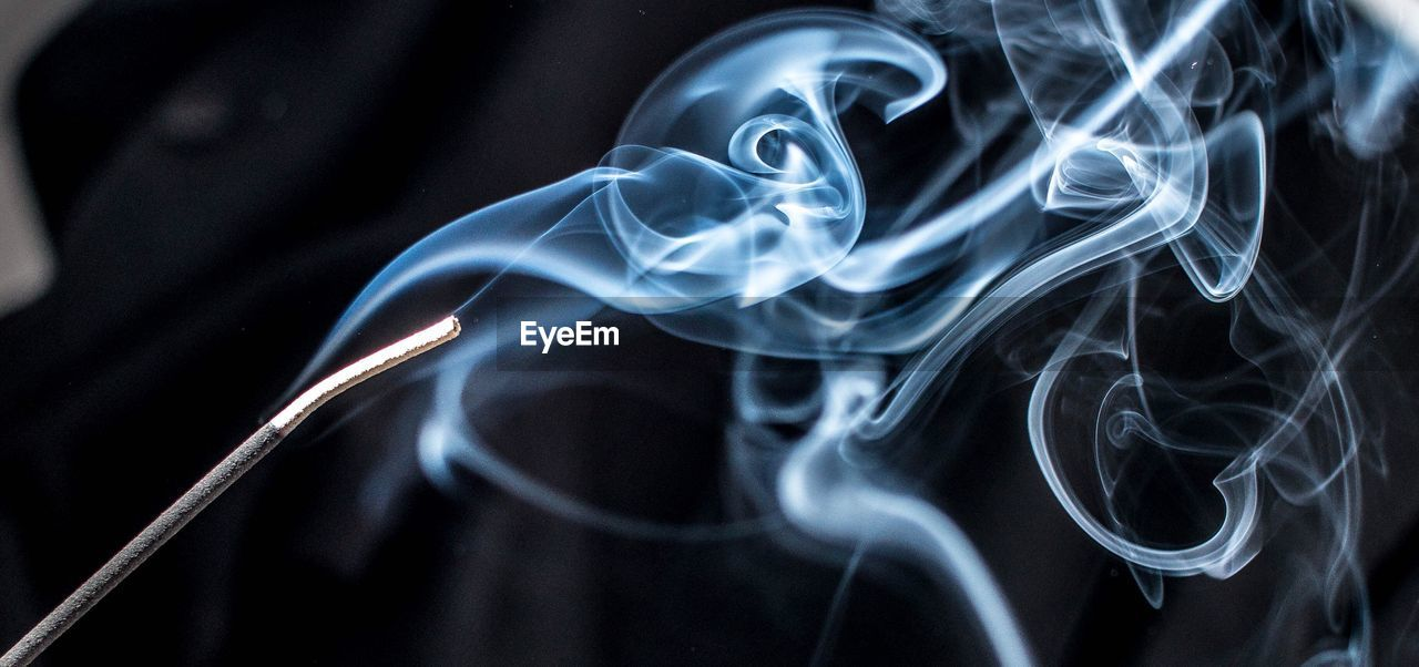 Close-Up Of Smoke Emitting From Incense Stick