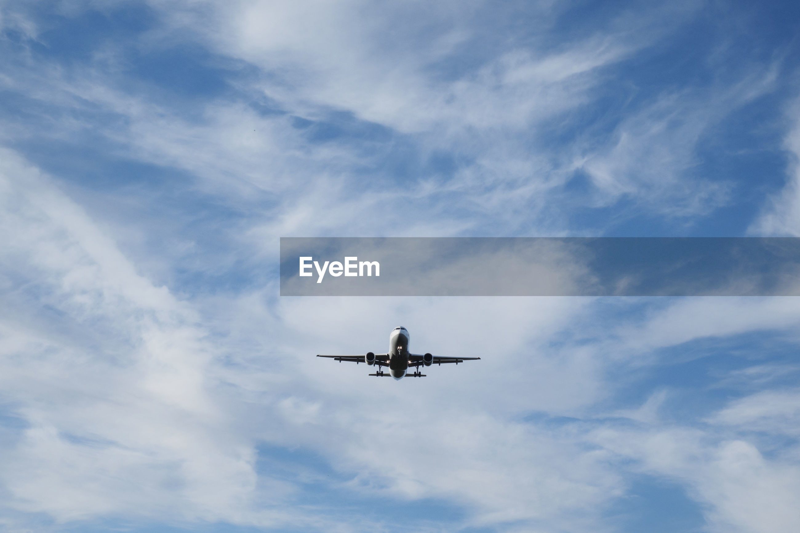 Low angle view of airplane against the sky
