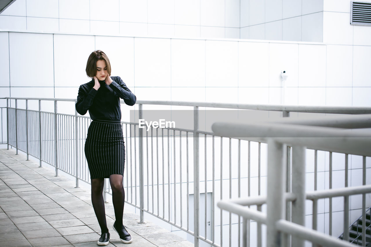 Young Woman Walking On Elevated Walkway