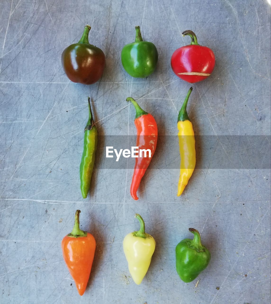 HIGH ANGLE VIEW OF FRUITS AND VEGETABLES ON GREEN CHILI