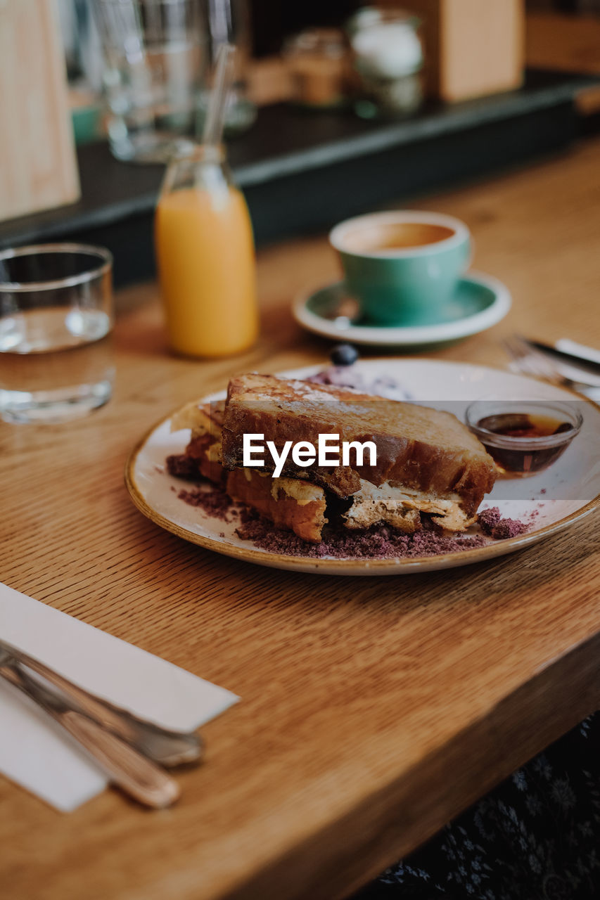 table, food and drink, food, plate, freshness, drink, ready-to-eat, indoors, serving size, cup, still life, wood - material, no people, refreshment, mug, coffee cup, selective focus, household equipment, meal, focus on foreground, glass, breakfast, crockery, temptation, french food