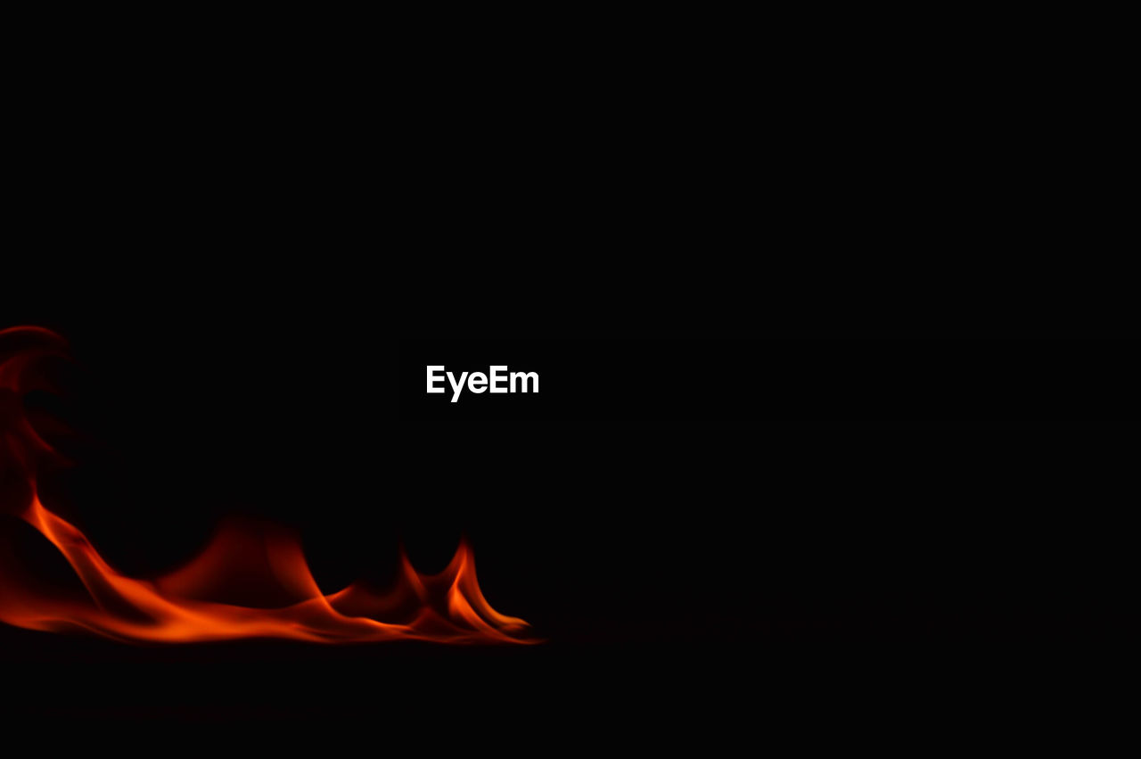heat - temperature, flame, burning, copy space, black background, studio shot, no people, night, motion, close-up, nature, outdoors
