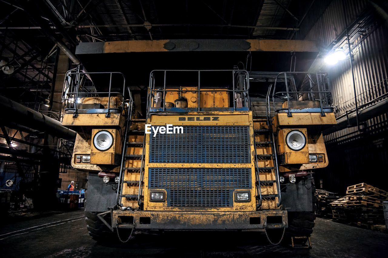 industry, metal, no people, machinery, transportation, indoors, factory, equipment, old, architecture, technology, manufacturing equipment, mode of transportation, yellow, rail transportation, land vehicle, retro styled, track, railroad track, industrial equipment, metal industry, production line