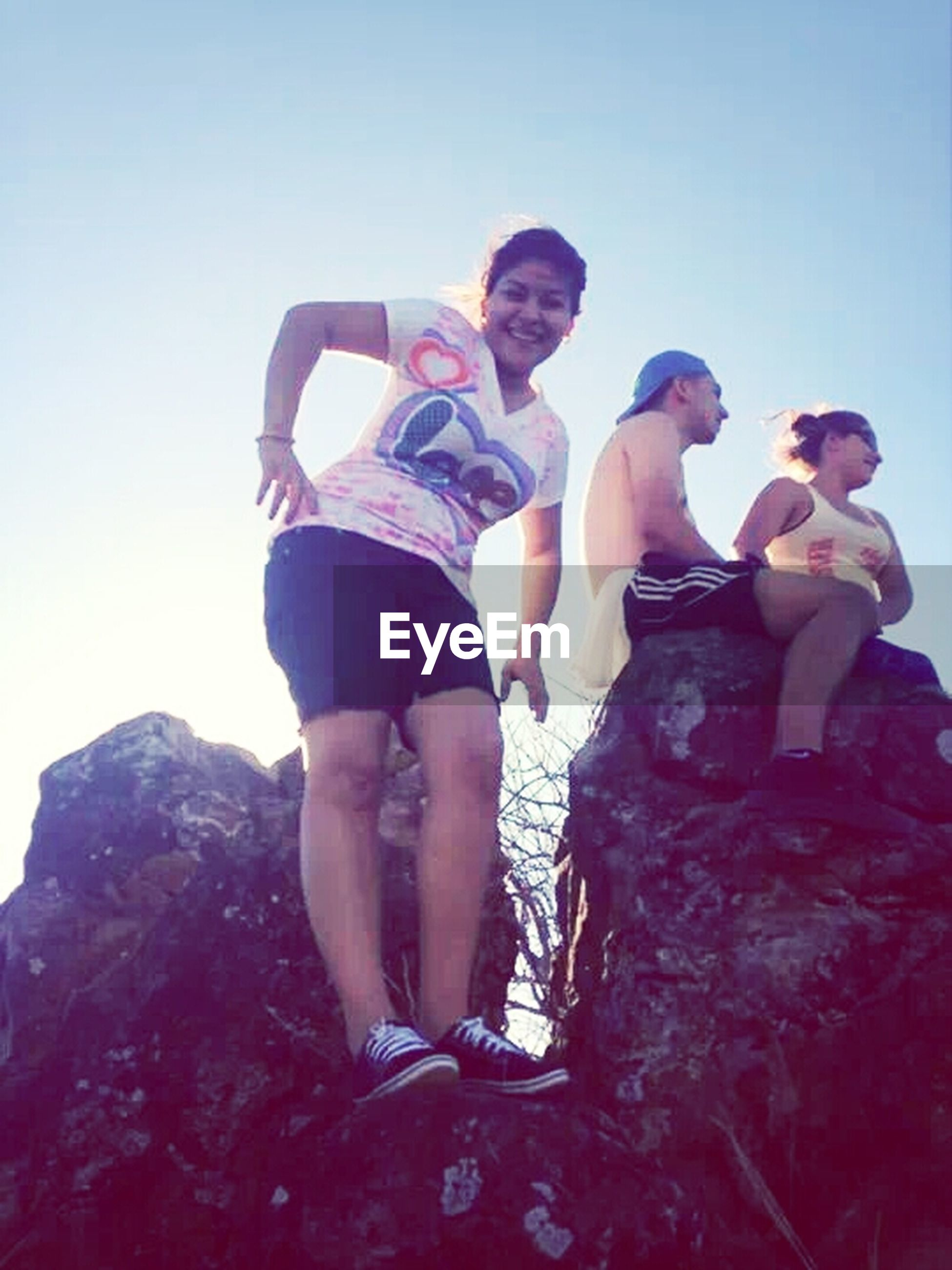lifestyles, leisure activity, togetherness, person, standing, bonding, love, casual clothing, childhood, rock - object, full length, clear sky, vacations, blue, girls, relaxation, family with one child