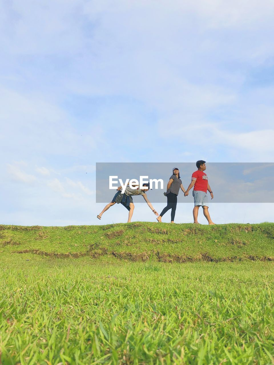grass, field, land, women, plant, sky, lifestyles, cloud - sky, real people, leisure activity, green color, nature, adult, men, beauty in nature, togetherness, casual clothing, day, environment, growth, outdoors, positive emotion, couple - relationship