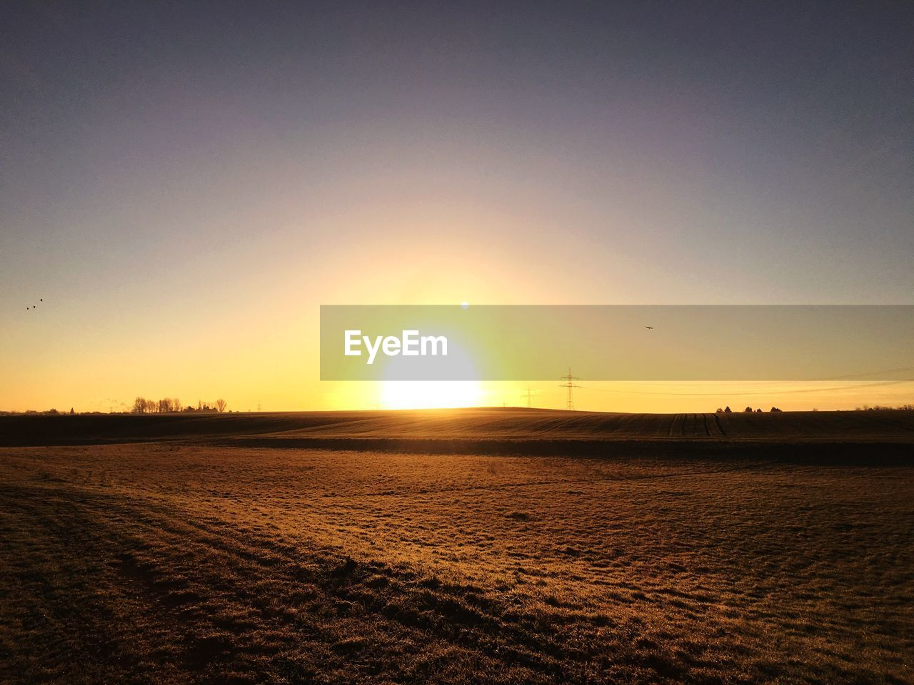 sunset, sun, orange color, nature, beauty in nature, tranquility, scenics, sky, outdoors, no people, tranquil scene, landscape, field, sunlight, silhouette, rural scene, clear sky, day