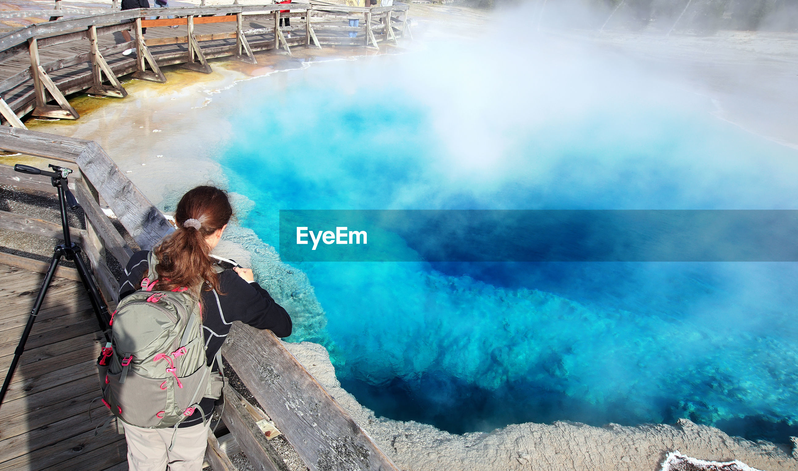 Rear View Of Woman Standing By Hot Spring
