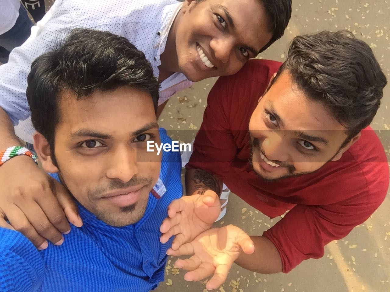 High Angle Portrait Of Smiling Friends Standing On Street