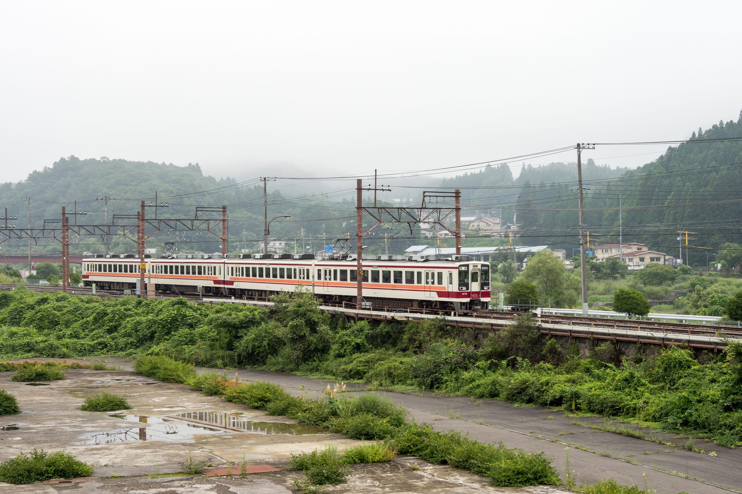 TRAIN ON RAILROAD TRACK IN FOGGY WEATHER