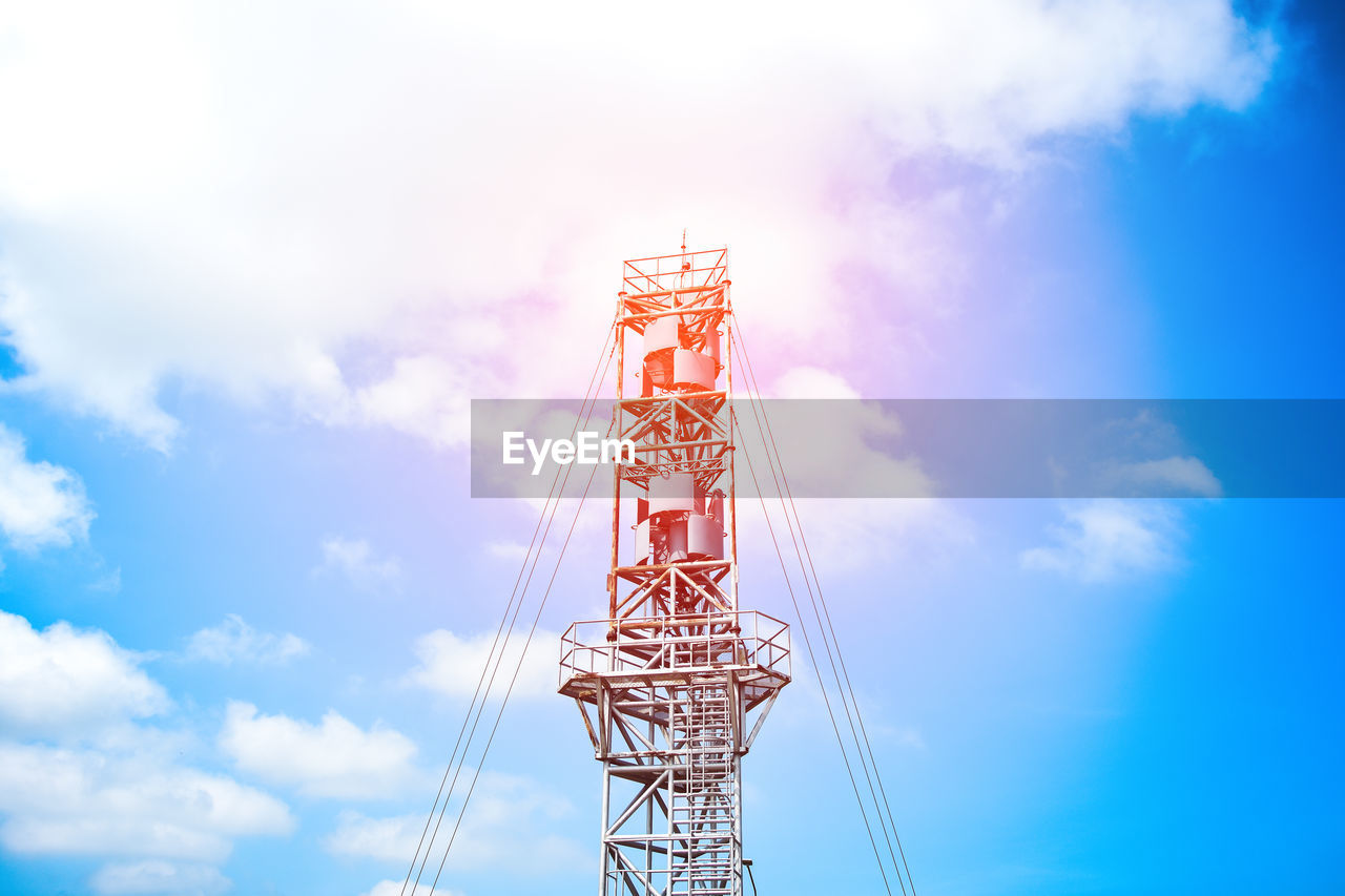 sky, low angle view, cloud - sky, built structure, nature, architecture, metal, tower, no people, global communications, day, communication, technology, blue, outdoors, tall - high, industry, connection, satellite