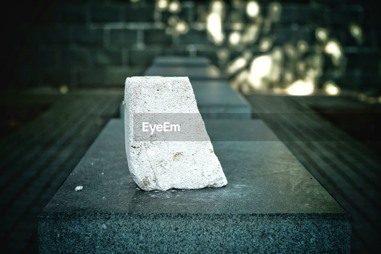 no people, day, focus on foreground, architecture, outdoors, close-up, built structure, solid, nature, concrete, selective focus, stone - object, direction, block, sunlight, wall, stone material, footpath, white color