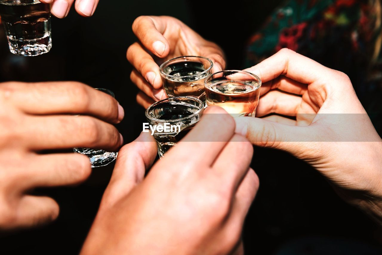 Cropped Hands Of Friendship Toasting Drinks