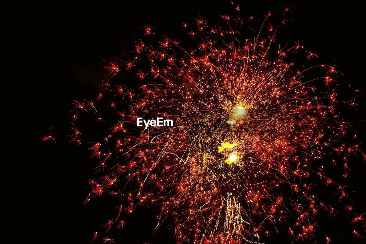 firework display, celebration, firework - man made object, exploding, night, low angle view, sparks, arts culture and entertainment, long exposure, event, motion, glowing, illuminated, blurred motion, firework, sky, outdoors, no people, smoke - physical structure, multi colored