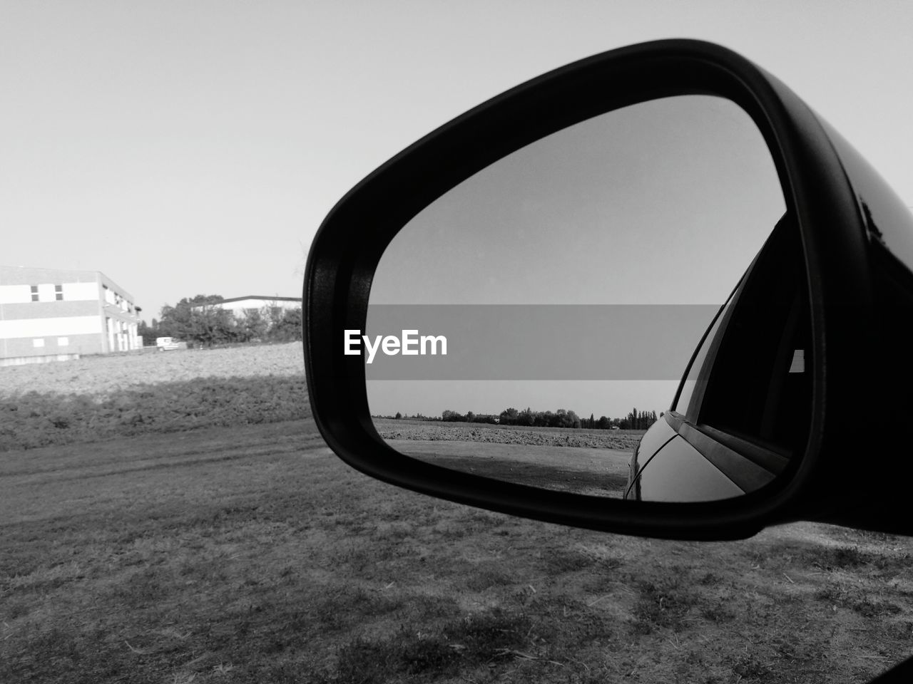 side-view mirror, car, reflection, mirror, transportation, land vehicle, window, mode of transport, clear sky, vehicle mirror, day, sky, no people, outdoors, close-up, road, nature, vehicle part, tree