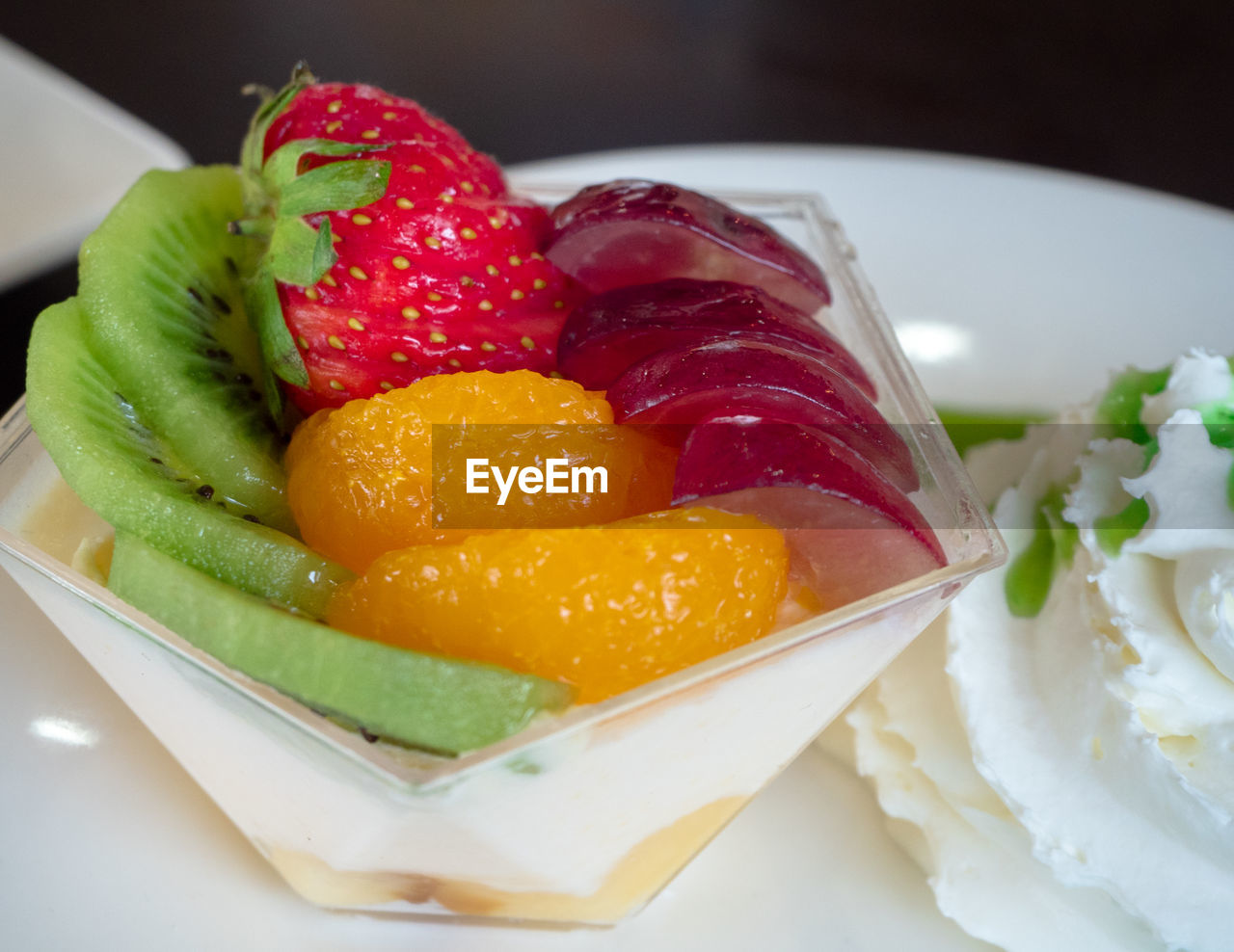 food and drink, food, freshness, healthy eating, plate, fruit, ready-to-eat, still life, indoors, close-up, serving size, wellbeing, strawberry, berry fruit, indulgence, kiwi, no people, salad, sweet food, high angle view, temptation, fruit salad, garnish, tray