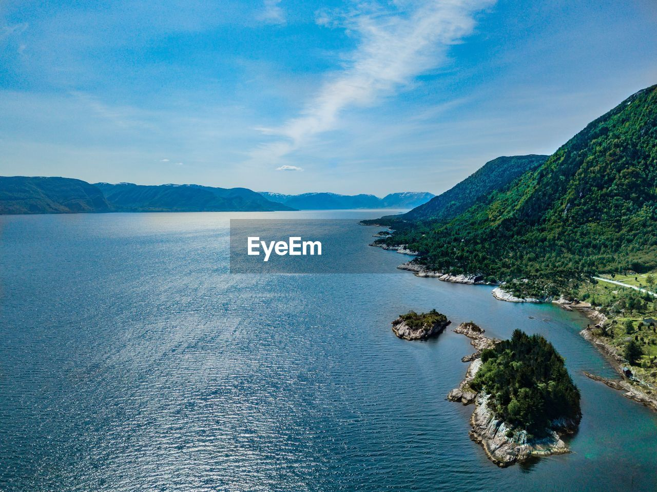 water, scenics - nature, beauty in nature, sky, tranquil scene, sea, tranquility, mountain, cloud - sky, no people, idyllic, nature, day, blue, tree, waterfront, plant, non-urban scene, outdoors, bay