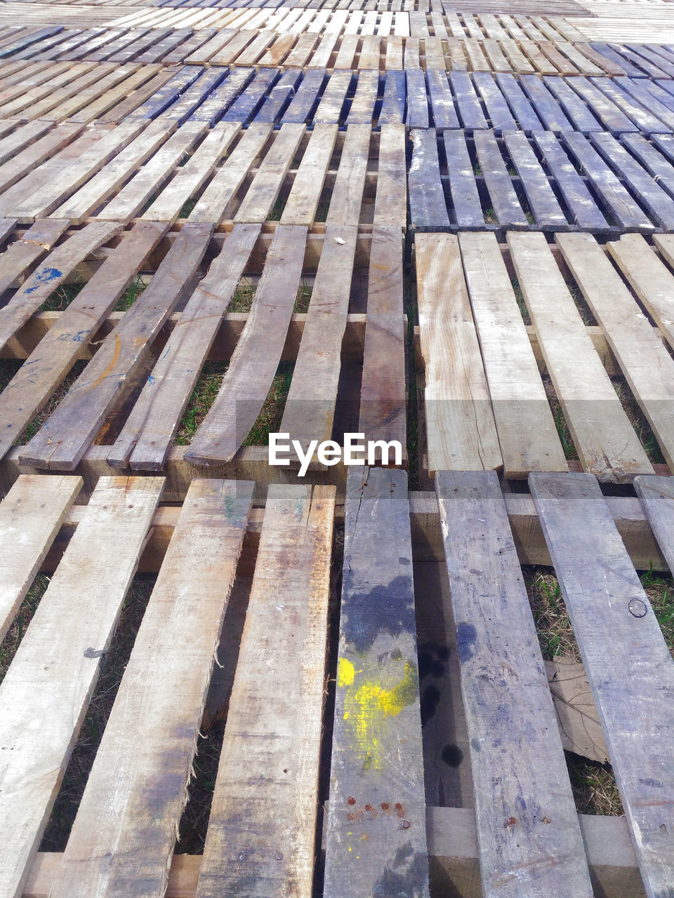 wood - material, pattern, full frame, high angle view, no people, day, backgrounds, nature, flooring, outdoors, absence, sunlight, wood, architecture, close-up, repetition, in a row, seat, order, textured