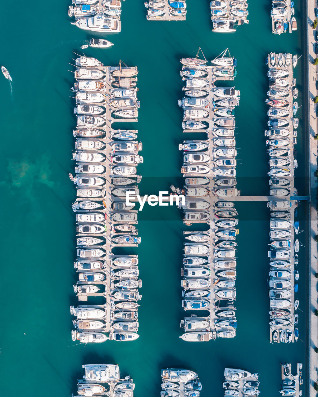 no people, water, architecture, built structure, building exterior, day, directly above, transportation, aerial view, nature, nautical vessel, pattern, outdoors, waterfront, large group of objects, high angle view, building, side by side, swimming pool