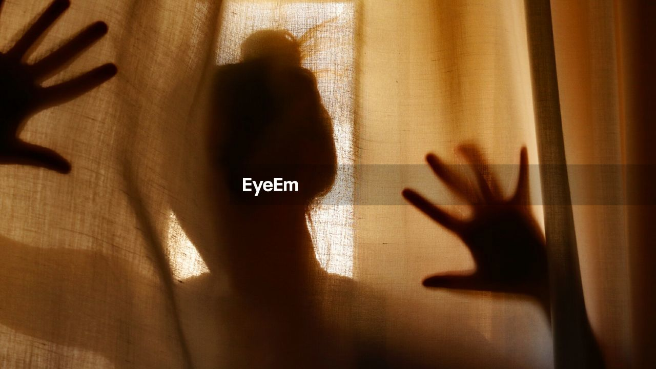 Shadow Of Woman Hand On Curtain At Home